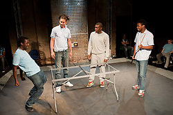 "© Copyright licensed to London News Pictures. 12/11/2010. ""Inside"" by Philip Osment, presented by Playing Out at the Roundhouse, Camden, London. Based on the real experiences of young fathers in prison, the play deals with big questions surrounding relationships, both with their own fathers and with their children. L to R: Michael Amaning, Kyle Thorne, Ayo Bodunrin, Darren Douglas."