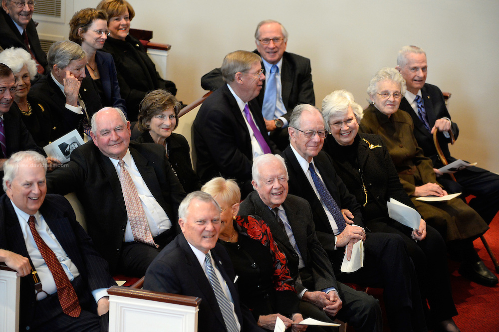 Georgia Gov. Nathan Deal and former governors President Jimmy Carter, Joe Frank Harris and Zell Miller, front row, with Roy Barnes, Sonny Perdue, and U.S. Sen. Johnny Isakson, R-Ga., and former U.S. Sen. Sam Nunn, D-Ga., back row, smile as they reminisce during a memorial service for Georgia Gov. Carl Sanders at Second Ponce de Leon Baptist Church on Saturday, Nov. 22, 2014, in Atlanta. Photo by David Tulis