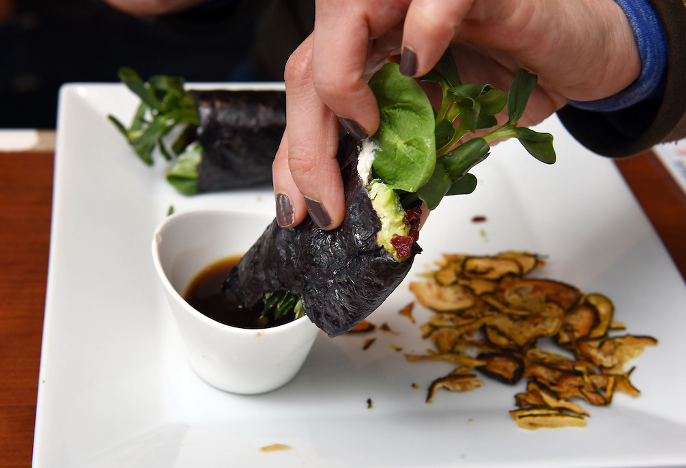 Mara Lavitt /For Hearst Connecticut Media<br /> February 6, 2016<br /> Catch A Healthy Habit Cafe, Fairfield. Anna Kokkinos of Norwalk dips the nori wrap: nori, fig marmalade, cashew &quot;cheese,&quot; beet, sunflower sprouts, avocado, crispy onion, spinach, &quot;salt &amp; vinegar&quot; zucchini chips.
