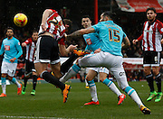 Brentford defender Jack O'Connell gets a powerful header goalwards during the Sky Bet Championship match between Brentford and Derby County at Griffin Park, London, England on 20 February 2016. Photo by Andy Walter.