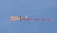 A banner is flown over the stadium saying 'Merci Arsene, We'll  miss you' during the Premier League match at the John Smiths Stadium, Huddersfield<br /> Picture by James Wilson/Focus Images Ltd 07522 978714<br /> 13/05/2018