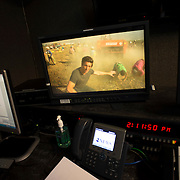 "August 29, 2014 - New York, NY : News Anchor David Muir (not visible in the room, but in the foreground on the video screen) reviews footage from a shoot he did along the Syrian border, in a screening room at ABC on West 66th Street on Friday afternoon. David Muir is taking over for Diane Sawyer as anchor of ABC's ""World News Tonight."" CREDIT: Karsten Moran for The New York Times"