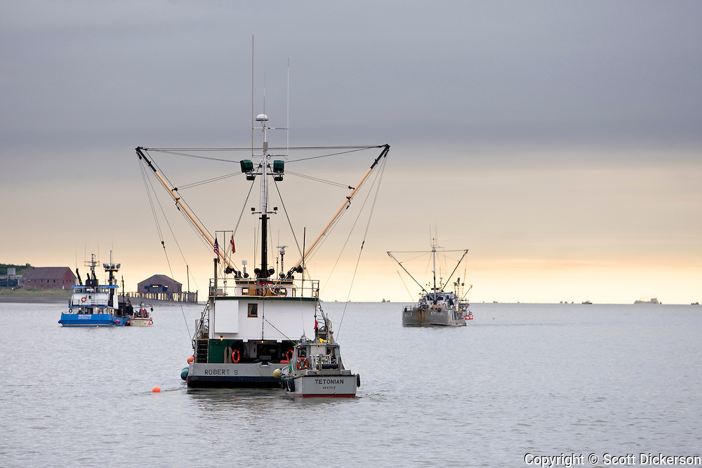 The Tetonian, a commercial fishing salmon gillnetter, trails behind the Robert S, a tender vessel, on the Naknek River in Bristol Bay, Alaska.