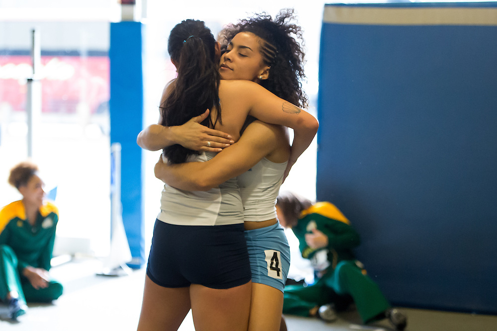 KINGSTON, RI - FEBRUARY 21: Janel Conley #129 of Rhode Island gets a hug from a teammate after the women's 60-meter hurdles during Day 2 of the Atlantic 10 Indoor Track and Field Championships at Mackal Field House at the University of Rhode Island on February 21, 2016, in Kingston, Rhode Island. (Photo by Daniel Petty/Atlantic 10)