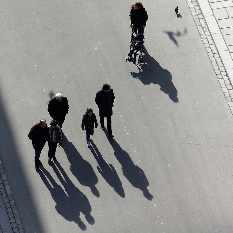 Shadows of people seen from above in the towers of Notre Dame, Paris