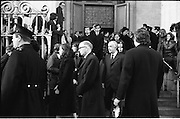 Funeral of Sinead Bean DeValera.    (H82)..1975..09.01.1975..01.09.1975..9th January 1975..Today saw the funeral of Sinead Bean DeValera take place at the Pro Cathedral, Dublin. She was the wife of Ex-President Eamon DeValera. Mrs Devalera was a noted author of childrens literature..Mrs DeValera, Born 3rd June 1878. Died 7th Jan 1975...Image of family and friends of the late Sinead Bean DeValera as they leave the Pro-Cathedral on their way to Glasnevin Cemetery.