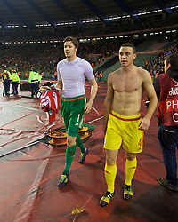 BRUSSELS, BELGIUM - Sunday, November 16, 2014: Wales' goalkeeper Wayne Hennessey and James Chester celebrate a point and staying top of the group after a goal-less draw against Belgium during the UEFA Euro 2016 Qualifying Group B game at the King Baudouin [Heysel] Stadium. (Pic by David Rawcliffe/Propaganda)
