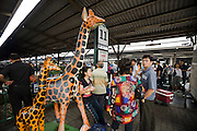 Eastern & Oriental Express. Bangkok Hualampong Station. A safari park ad wit plastic giraffes.
