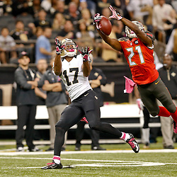 Oct 5, 2014; New Orleans, LA, USA; Tampa Bay Buccaneers cornerback Alterraun Verner (21) breaks up a pass to New Orleans Saints wide receiver Robert Meachem (17) during the first quarter of a game at Mercedes-Benz Superdome. Mandatory Credit: Derick E. Hingle-USA TODAY Sports