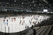 Guests take to the ice for open skate at the dedication ceremony for the Gene Polisseni Center at RIT on Thursday, September 18, 2014.