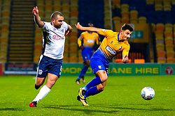 Stephen Dawson of Bury chases down Otis Khan of Mansfield Town - Mandatory by-line: Ryan Crockett/JMP - 04/12/2018 - FOOTBALL - One Call Stadium - Mansfield, England - Mansfield Town v Bury - Checkatrade Trophy
