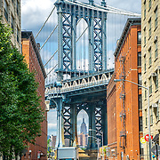 View of Manhattan Bridge and the Empire State Building from Dumbo in Brooklyn NYC. Photo by Alabastro Photography.