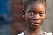 Portrait of a teenage girl in the Clara Town slum of Monrovia, Montserrado county, Liberia on Thursday April 5, 2012.