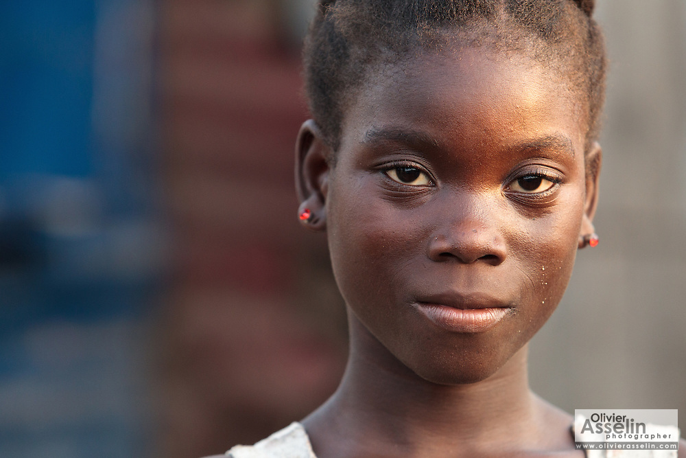 Portrait of a teenage girl in the Clara Town slum of Monrovia, Montserrado county, Liberia on Thursday April 5, 2012.