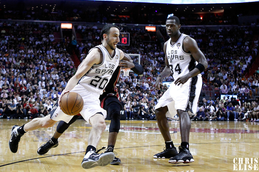 14 March 2011: San Antonio Spurs shooting guard Manu Ginobili (20) drives past Miami Heat shooting guard Dwyane Wade (3) and San Antonio Spurs power forward Antonio McDyess (34) during the Miami Heat 110-80 victory over the San Antonio Spurs at the AmericanAirlines Arena, Miami, Florida, USA.