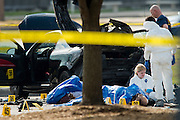 FBI agents comb through the car of two shooters outside of the Curtis Culwell Center in Garland, Texas on May 4, 2015.  (Cooper Neill for The New York Times)