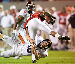 Virginia punter Ryan Weigand (16) tackles North Carolina State wide receiver Darrell Blackman (2).  The North Carolina State Wolfpack faced the #15 Virginia Cavaliers at Carter Finley Stadium in Raleigh, NC on October 27, 2007.