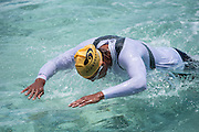 Open water swimmer make thier way in several legs around the island of Bora Bora on Day 2 of the Ironmana.