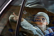 Summer Moll, age 4,  put a kiss on the car window for her father Joshua Moll while leaving Tampa General Hospital. Moll was severely injured and her mother Jennifer O' Boyle died when their car was struck by a driver going the wrong way on the Lee Roy Selmon Expressway in Tampa.