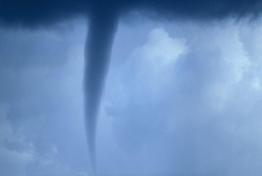 USA, Alaska, Denali National Park, Rare funnel cloud appears during late summer thunderstorm near Wonder Lake