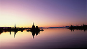 Dawn glow on Mono Lake, California, with tufa towers reflections