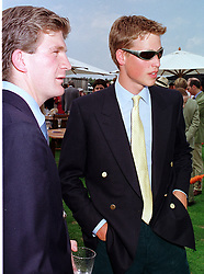 Left to right, the HON.PEREGRINE HOOD and HRH PRINCE WILLIAM, at a polo match in Berkshire on 25th July 1999.MUM 227
