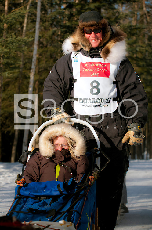 Musher Kris Hoffman and Iditarider Thelma Zint ride along the Chester Creek Trail during the 2011 Iditarod Ceremonial Start.