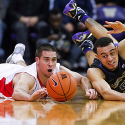 Arizona Wildcats guard T.J. McConnell (4) dives for a loose ball against Washington Huskies guard Nigel Williams-Goss (5) during the second half at Alaska Airlines Arena. Arizona defeated Washington, 86-62.