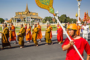 "05 FEBRUARY 2013 - PHNOM PENH, CAMBODIA: The procession carrying King-Father Norodom Sihanouk's ashes passes the Royal Palace in Phnom Penh. Sihanouk's ashes will be scattered in locations across Cambodia. Tuesday, they were scattered on the Mekong River. Norodom Sihanouk (31 October 1922 - 15 October 2012) was the King of Cambodia from 1941 to 1955 and again from 1993 to 2004. He was the effective ruler of Cambodia from 1953 to 1970. After his second abdication in 2004, he was given the honorific of ""The King-Father of Cambodia."" Sihanouk died in Beijing, China, where he was receiving medical care, on Oct. 15, 2012.    PHOTO BY JACK KURTZ"