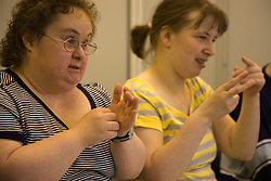 Day Service users with learning disabilities using makaton a way of communicating with signs and symbols specially for people with learning difficulties,