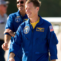 Space Shuttle Atlantis pilot Christopher Ferguson (R) smiles after arriving for a launch dress rehearsal in Cape Canaveral, Fla. on August 7, 2006. Ferguson will pilot the next mission aboard Space Shuttle Atlantis. REUTERS/Scott Audette (UNITED STATES)