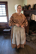 An actor portrays an 1800s farm woman at Conner Prairie Interactive History Park, Fishers, Indiana, USA. Conner Prairie provides family-friendly fun for all ages. Founded by pharmaceutical executive Eli Lilly in the 1930s, Conner Prairie living history museum now recreates life in Indiana in the 1800s on the White River and preserves the William Conner home (listed on the National Register of Historic Places). For licensing options, please inquire.