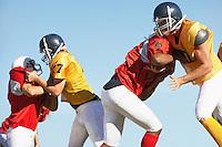 Football Players Tackling