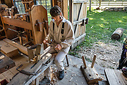 1800s style woodworking shop; wooden vise. Conner Prairie Interactive History Park provides family-friendly fun for all ages in Fishers, Indiana, USA. Founded by pharmaceutical executive Eli Lilly in the 1930s, Conner Prairie living history museum now recreates life in Indiana in the 1800s on the White River and preserves the William Conner home (listed on the National Register of Historic Places).