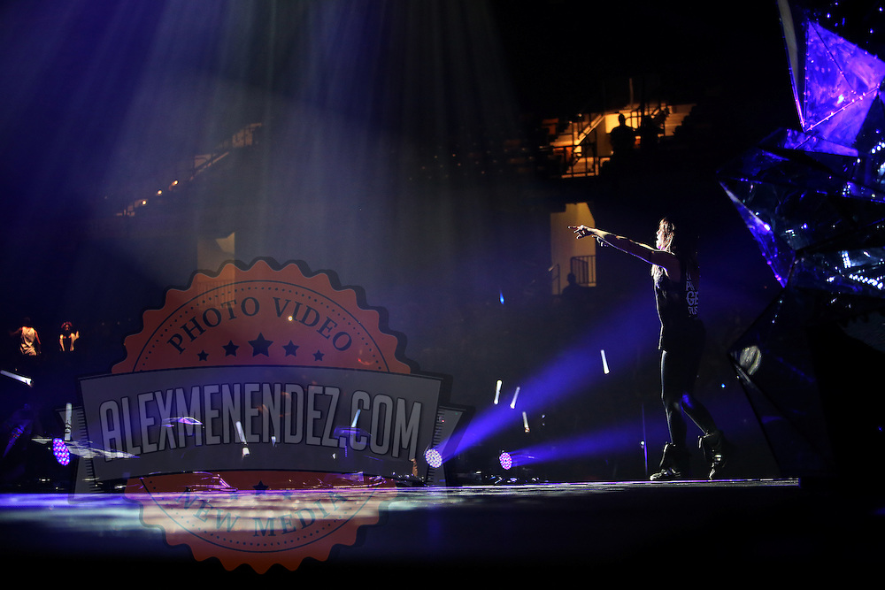 """Jahan Yousaf of the band Krewella performs in front of the """"Light Volcano"""", during the Verge Campus Spring Tour concert at the CFE Arena on the University of Central Florida campus, Tuesday, April 8, 2014, in Orlando, Florida.  (AP Photo/Alex Menendez)"""