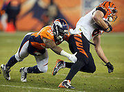 Cincinnati Bengals tight end Tyler Kroft (81) gets tackled by Denver Broncos defensive back Josh Bush (20) after catching a fourth quarter pass good for a first down in Broncos territory during the 2015 NFL week 16 regular season football game against the Denver Broncos on Monday, Dec. 28, 2015 in Denver. The Broncos won the game in overtime 20-17. (©Paul Anthony Spinelli)