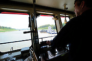{8/24/12} {10pmCST} - Greenville , MS, U.S.A. -- Sandbars creep up as the water level drops on the Mississippi River makeing navigating the Mississippi River difficult for tug boat captains Ron Mook , Friday August 24,2012. Historically low river levels on the Mississippi River are causing havoc on river traffic: grounding barges loaded with grain and fertilizer, traffic jams several miles long and forcing the Coast Guard to close down chunks of the river due to groundings. The area around Greenville, Miss., has closed three times the past week due to groundings. Last year, there were five total groundings the entire low-water season. Locals who fought historic high-water floods last year are this year engaged in a different fight: keeping barges afloat on a vanishing Mississippi.  -- Photo by Suzi Altman, Freelance.