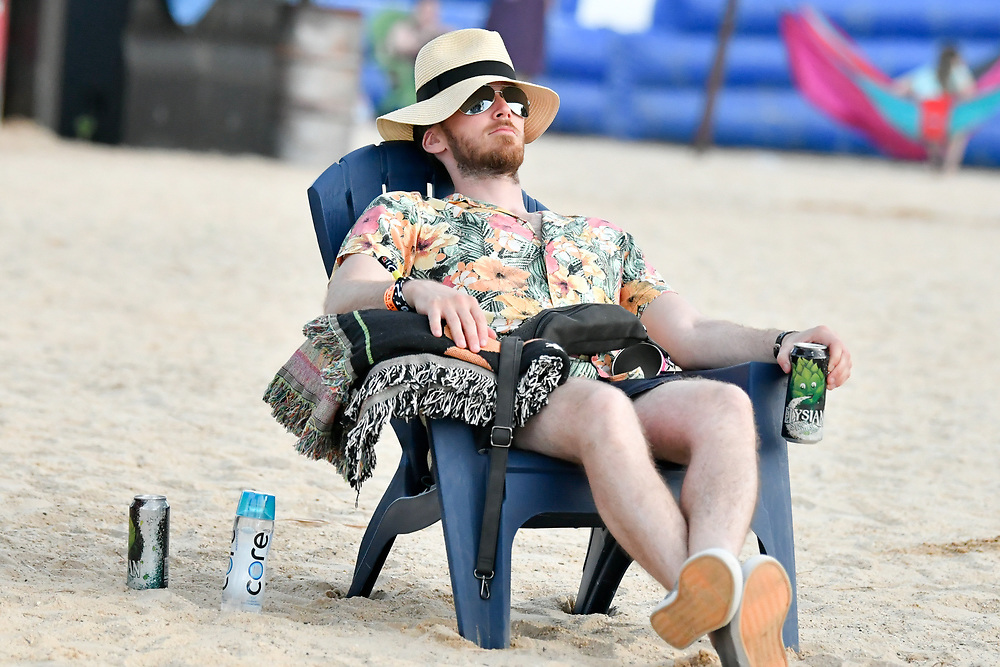 A  festival attendee takes some time to chill out and have a beer at The Bonnaroo Music and Arts Festival