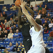 College of Charleston Forward Adjehi Baru (1) drives to the hoop as Delaware Forward Carl Baptiste (33) defends  in the second half of a NCAA regular season Colonial Athletic Association conference game between Delaware and The College of Charleston Wednesday, Feb 5, 2014 at The Bob Carpenter Sports Convocation Center in Newark Delaware.