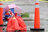 A steady rain is not going to stop children from watching the 2012 Holiday at Home Parade on Far Hills Avenue in Kettering, Monday, September 3, 2012.