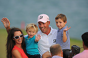 Matt Kuchar celebrates with his two sons Cameron, 4, right, Carson, 2, left and his wife Sybi after winning the Players Championship at the TPC Sawgrass on May 13, 2012 in Ponte Vedra, Fla. ..©2012 Scott A. Miller..