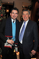 Left to right, EDWARD TAYLOR and his father NICHOLAS TAYLOR at a party hosted by TLC to celebrate signing their 5000th member and Ralph Lauren to celebrate the opening of the first Ralph Lauren Rugby store in the UK at 43 King Street, Covent Garden, London on 30th November 2011.