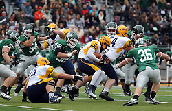 18 October 2014:  Jeff Jerome reaches for the back of runner Sam Frasco during an NCAA division 3 football game between the Augustana Vikings and the Illinois Wesleyan Titans in Tucci Stadium on Wilder Field, Bloomington IL