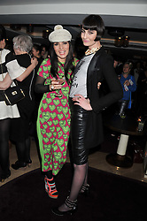 Left to right, GRACE WOODWARD and ERIN O'CONNOR at the launch of 'She Died of Beauty' as part of London Fashion Week Autumn/Winter 2012 held at The Club at The Ivy Club, London on 17th February 2012.