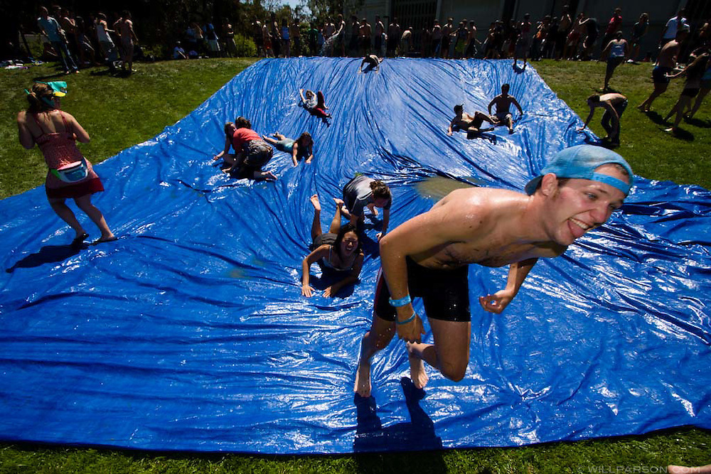 Students slide down Sun God lawn on the UC San Diego campus during the Sun God Festival on May 16, 2008 in San Diego, California.