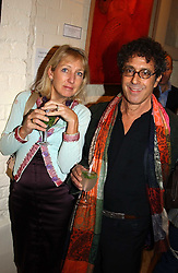 PETER ADLER and RICKY MOORES at an exhibition of recent work by artist Lance Tilbury held at the Old Imperial Laundry, Warriner Gardens, Battersea, London on 7th December 2004.<br /><br />NON EXCLUSIVE - WORLD RIGHTS