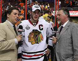 June 9, 2010; Philiadelphia, PA; USA;  Chicago Blackhawks center Jonathan Toews (19) is interviewed by Steve Levy (l) and Barry Melrose (r) after the Blackhawks defeated the Flyers 4-3 in Game 6 of the Stanley Cup Finals at the Wachovia Center.