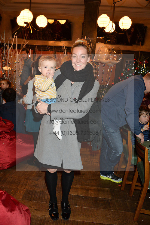 TV presenter CHERRY HEALEY and her son BEAR at a party hosted by Camila Batmanghelidjh for Kids Company held at The Ivy Market Grill, 1 Henrietta Street, Covent Garden, London on 23rd November 2014.