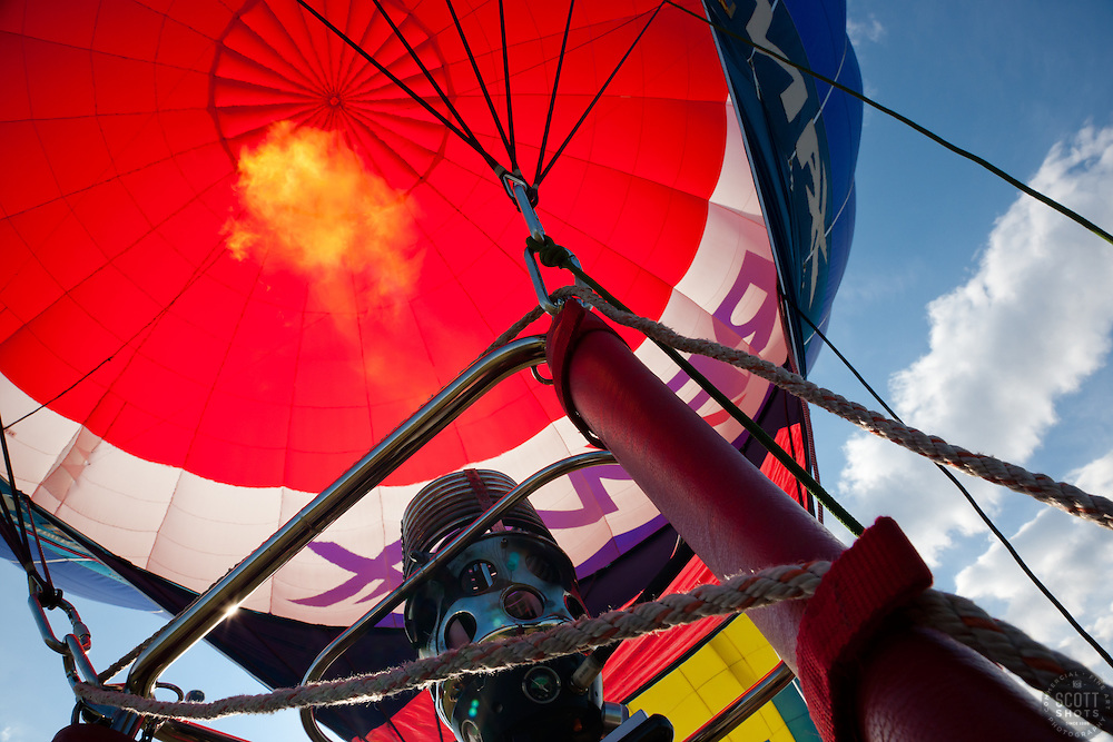 """""""Take Off 1"""" - This photograph of a hot air balloon firing up and taking off was photographed at the 2011 Great Reno Balloon Race. Photographed from inside the hot air balloon basket."""
