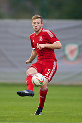NEWPORT, WALES - Thursday, September 25, 2014: Wales' Daniel Jefferies in action against France during the Under-16's International Friendly match at Dragon Park. (Pic by David Rawcliffe/Propaganda)
